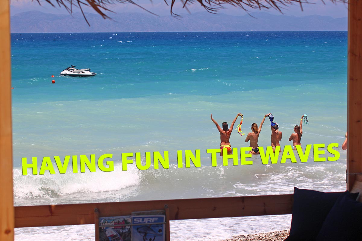girls having fun in waves