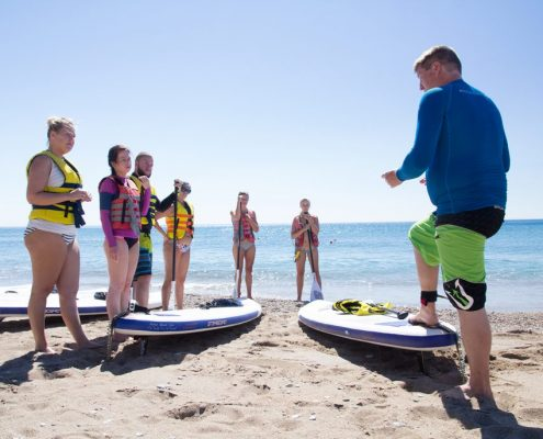 Stand up paddle boarding lesson, Ixia, Rhodes, Greece.