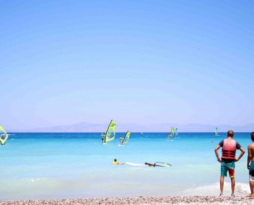 Beginner windsurfers at Surfers Paradise Ixia, Rhodes, Greece.